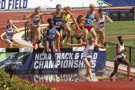 Runners compete in the women's steeplechase at the NCAA Division I Outdoor Track and Field Championships, Saturday, June 12, 2021, at Hayward Field in Eugene, Ore. Air Force's Mahala Norris, third from left, about to land in water, won the race. (AP Photo/Thomas Boyd)