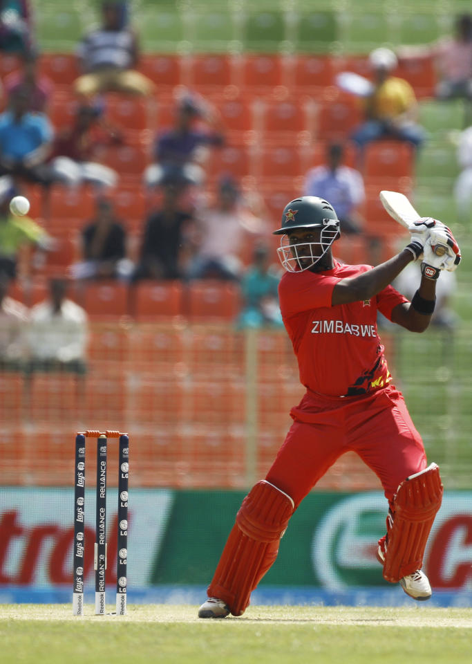 Zimbabwe's Elton Chigumbura plays a shot during their ICC Twenty20 Cricket World Cup match against United Arab Emirates, in Sylhet, Bangladesh, Friday, March 21, 2014. (AP Photo/A.M. Ahad)