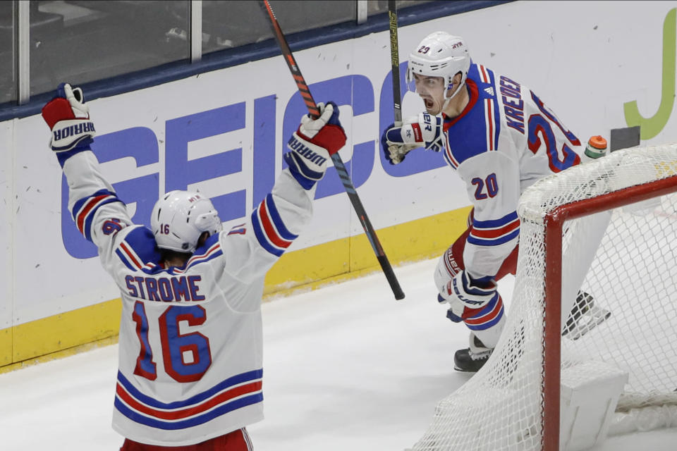 New York Rangers' Chris Kreider (20) celebrates with teammate Ryan Strome (16) after scoring the game winning goal during the third period of an NHL hockey game against the New York Islanders Thursday, Jan. 16, 2020, in Uniondale, N.Y. The Rangers won 3-2. (AP Photo/Frank Franklin II)