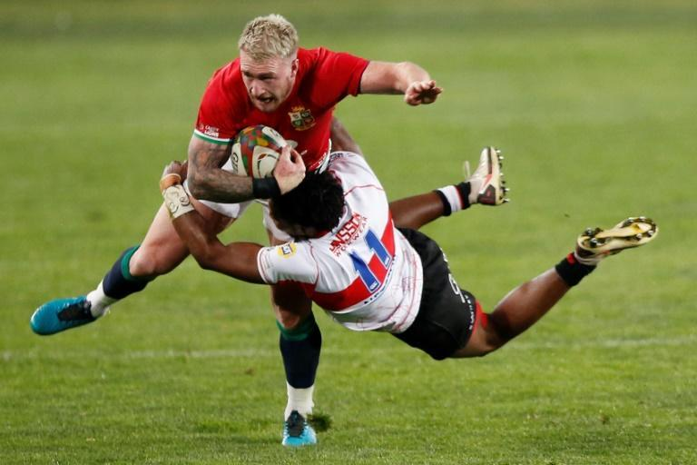 British and Irish Lions captain and full-back Stuart Hogg (L) is tackled by Lions wing Rabz Maxwane (R) during a tour match at Ellis Park in Johannesburg on Saturday.