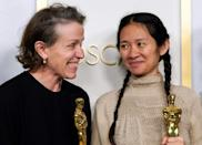 Chloe Zhao (R) helped to explain Frances McDormand's primal howl on stage