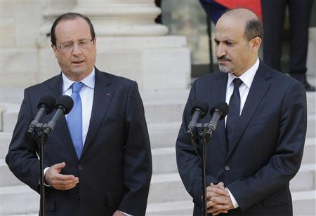 French President Francois Hollande and Ahmad Jarba, head of the opposition Syrian National Coalition, speak to journalists at the Elysee Palace in Paris
