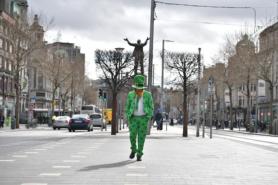 A lone reveler marks St. Patrick's Day by walking down Dublin's parade route after the annual event was canceled due to coronavirus concerns. (Photo: Charles McQuillan/Getty Images)
