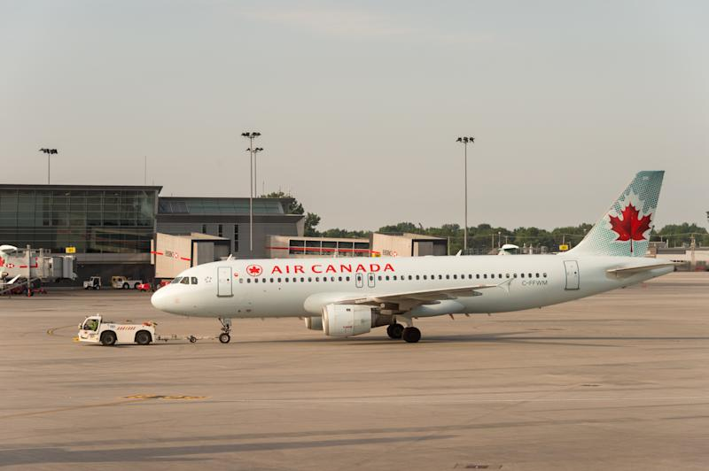 Montreal, CA - 17 August 2017: Air Canada commercial planes on the tarmac of Montreal Pierre Elliott Trudeau International Airport