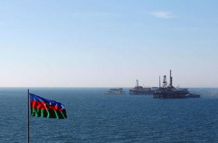 FILE PHOTO: The state flag of Azerbaijan flutters in the wind on an oil platform in the Caspian Sea