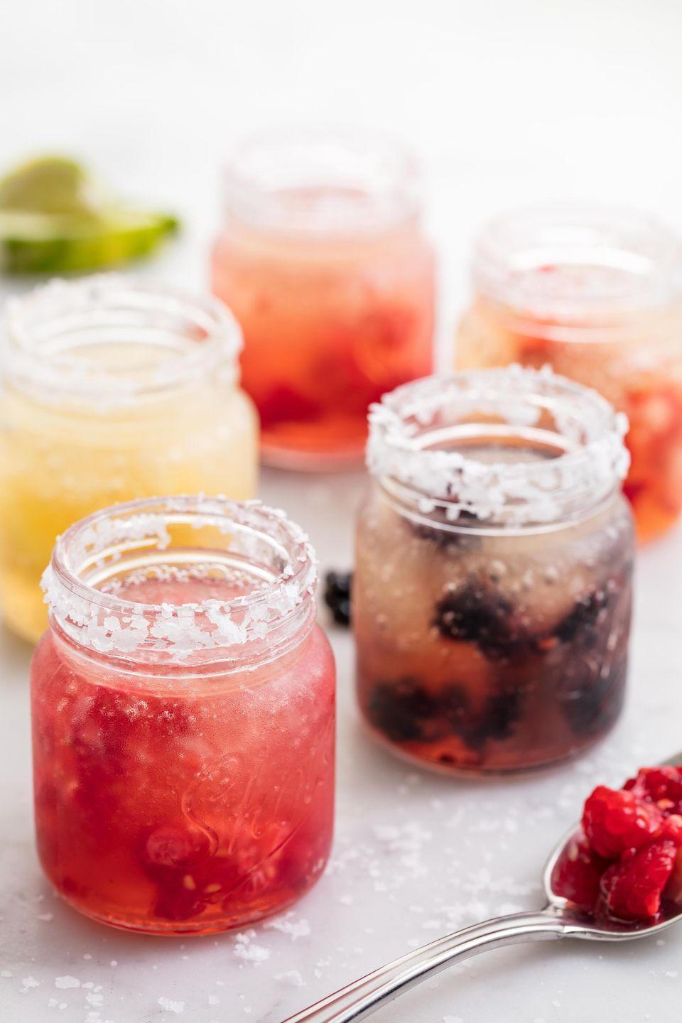 """<p>These drinks are customizable and totally adorable!</p><p>Get the recipe from <a href=""""https://www.delish.com/entertaining/recipes/a42927/slushy-margarita-shots/"""" rel=""""nofollow noopener"""" target=""""_blank"""" data-ylk=""""slk:Delish"""" class=""""link rapid-noclick-resp"""">Delish</a>.</p>"""