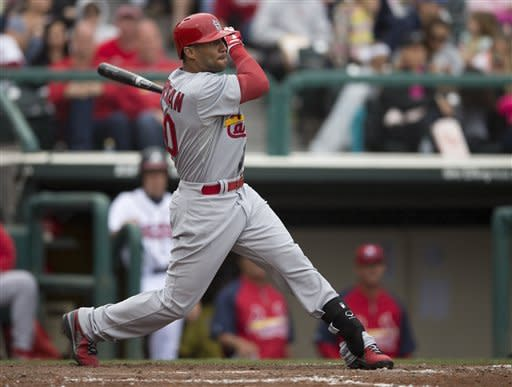 St. Louis Cardinals' Justin Christian hits a two-run triple during the seventh inning of an exhibition spring training baseball game against the Atlanta Braves on Tuesday, March 12, 2013, in Kissimmee, Fla. (AP Photo/Evan Vucci)