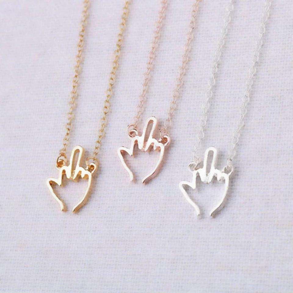 <p>If they love to layer necklaces, they'll appreciate this subtle <span>Middle Finger Necklace</span> ($18). It comes in gold, rose gold, and silver. </p>