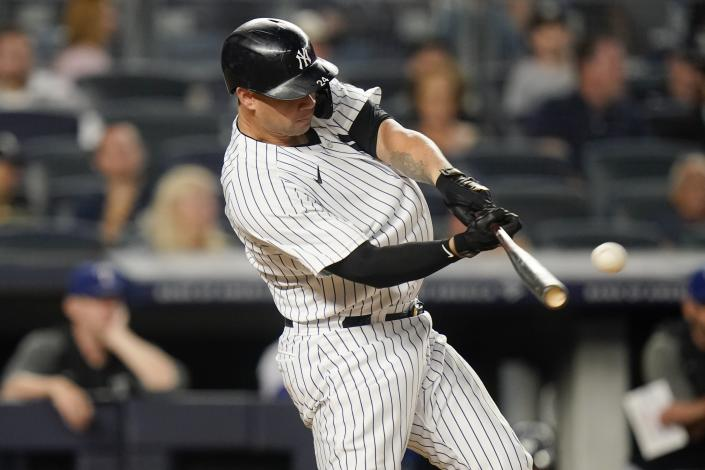New York Yankees' Gary Sanchez hits a home run during the second inning of a baseball game against the Texas Rangers, Monday, Sept. 20, 2021, in New York. (AP Photo/Frank Franklin II)