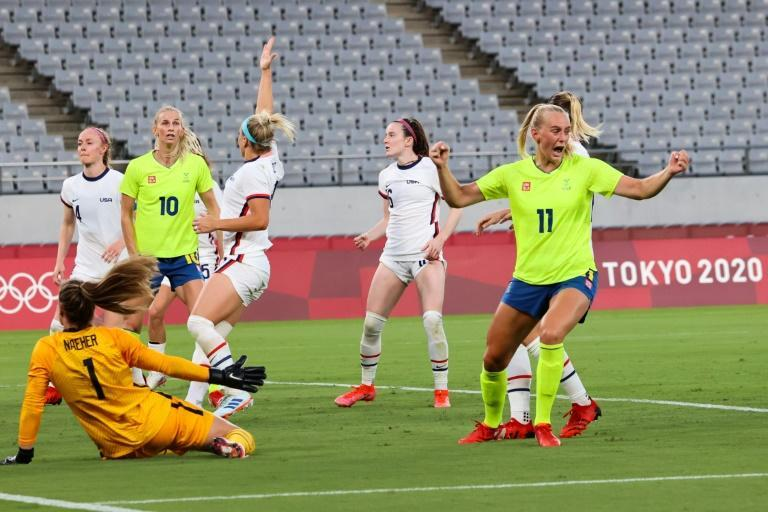 Stina Blackstenius (R) scored twice as Sweden inflicted a 3-0 defeat on four-time Olympic champions the United States