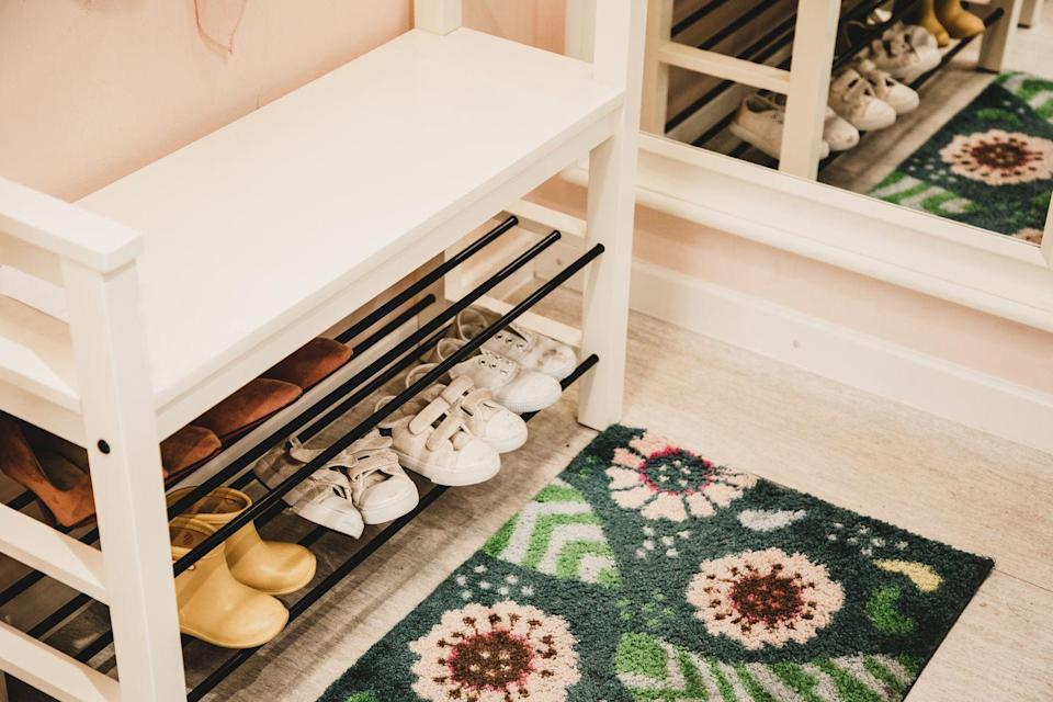 """<p>Having family and friends traipse through your home in their shoes isn't just making the floors dirty, but it's also dragging in lots of gross germs. Taylor recommends dedicating an area for people to take their shoes off when they enter.</p><p>""""Allergens and chemicals come in with shoes and can be tracked all over the house so easily,"""" she says. """"Have a few pairs of indoor only slippers in that spot for guests to use if they would like."""" </p><p><strong>BUY NOW</strong>: <a href=""""https://www.amazon.com/BAMEOS-Stackable-Storage-Organizer-Entryway/dp/B08BR1V4D1/ref=sr_1_6?dchild=1&keywords=shoe+rack&qid=1600101213&refinements=p_72%3A2661618011&rnid=2661617011&sr=8-6"""" rel=""""nofollow noopener"""" target=""""_blank"""" data-ylk=""""slk:2-tier shoe rack"""" class=""""link rapid-noclick-resp"""">2-tier shoe rack</a> ($22)</p>"""