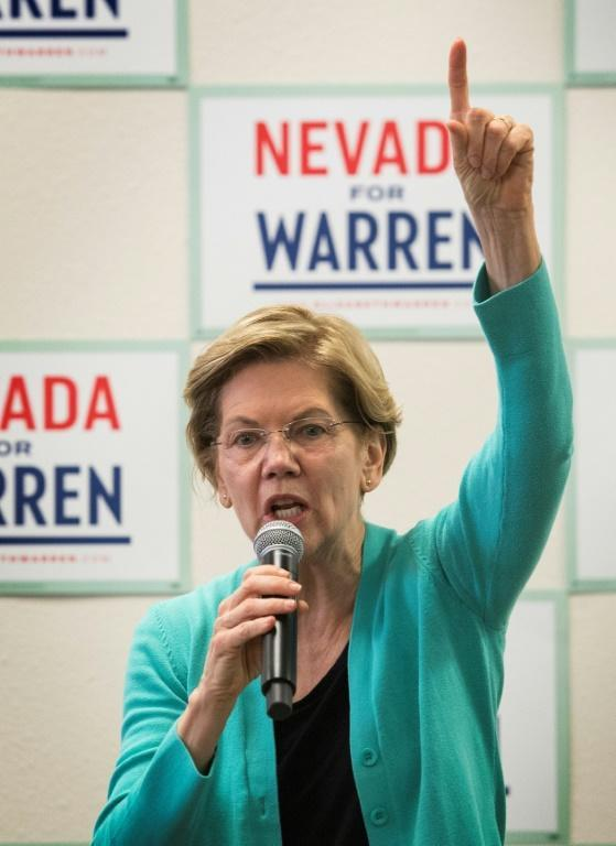 Presidential hopeful Senator Elizabeth Warren redoubled her sharp criticism of billionaire former New York mayor Michael Bloomberg, the latest entrant in the 2020 Democratic nomination race, after the party's debate in Las Vegas (AFP Photo/Mark RALSTON)