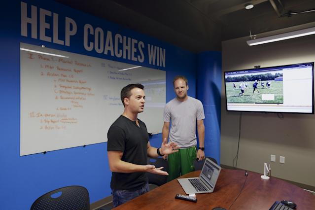 In this photo from Aug. 14, 2014, David Graff, CEO of Hudl, right, listens to John Wirtz, Chief Product Officer, in Lincoln, Neb. Hudl is a software company that has developed a way to immediately get game film to coaches after games and break down and separate different plays by type. (AP Photo/Nati Harnik)