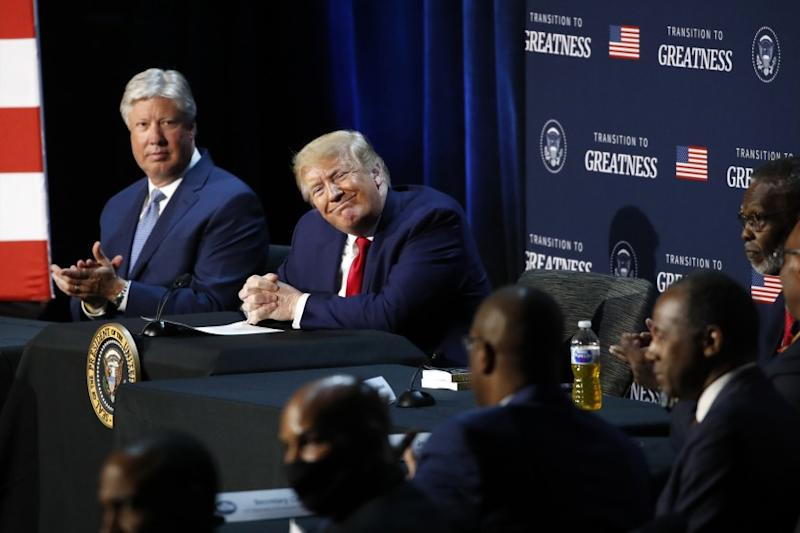 """President Donald Trump smiles during a roundtable discussion about """"Transition to Greatness: Restoring, Rebuilding, and Renewing,"""" at Gateway Church Dallas, Thursday, June 11, 2020, in Dallas.(AP Photo/Alex Brandon)"""