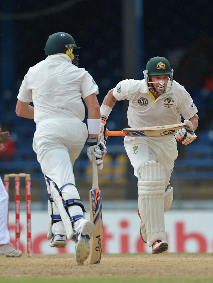 Australian batsmen Michael Hussey (R) and James Pattinson (L) run during the second day of the second-of-three Test matches between Australia and West Indies April 16, 2012 at Queen's Park Oval in Port of Spain.     AFP PHOTO/Stan HONDA (Photo credit should read STAN HONDA/AFP/Getty Images)