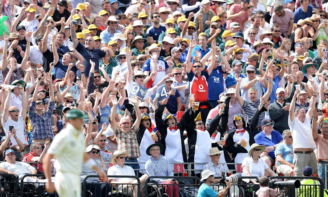 Cricket fans enjoy day three of the Third Investec Ashes test match at Old Trafford Cricket Ground, Manchester.