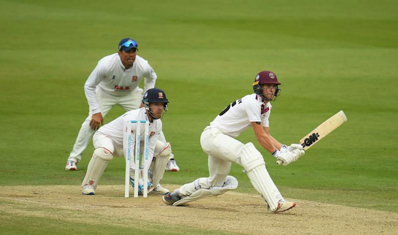 Tom Lammonby plays a shot as Adam Wheater and Sir Alastair Cook look onGetty