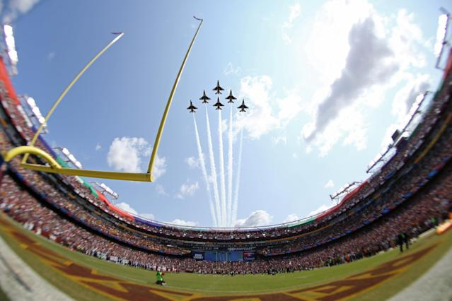<p>A squadron of F-16s perform a flyover prior to the game between the Philadelphia Eagles and the Washington Redskins at FedEx Field. Mandatory Credit: Geoff Burke-USA TODAY Sports </p>