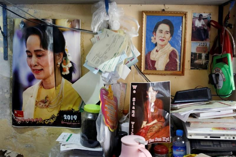 Photos of Myanmar State Counselor Aung San Suu Kyi are seen in a shop in Yangon