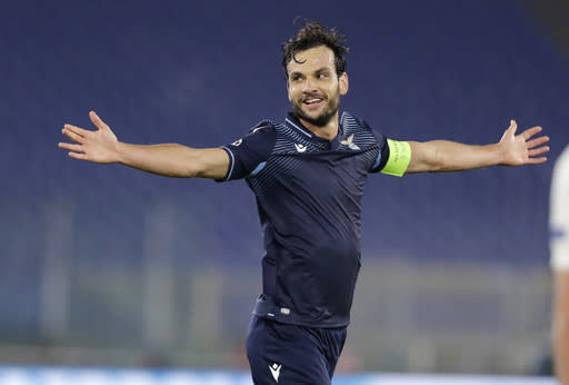 Lazio's Marco Parolo celebrates after scoring his side's second goal during a Champions League group F soccer match between Lazio and Zenit Saint Petersburg, at Rome's Olympic Stadium, Tuesday, Nov. 24, 2020. (AP Photo/Andrew Medichini)