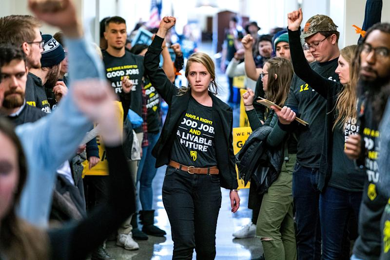 Supporters of the Green New Deal rally outside the office of Democratic Congressman from Maryland and House Minority Whip Steny Hoyer in Washington, DC, December 2018.