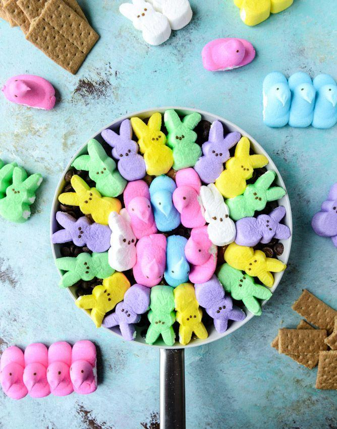 "<p>Put all those fluffy Peeps to good use with this fun skillet recipe. Your kids will love dipping their graham crackers into the gooey colorful dip.</p><p><strong>Get the recipe at <a href=""https://www.howsweeteats.com/2015/04/chocolate-peanut-butter-peeps-skillet-smores/"" rel=""nofollow noopener"" target=""_blank"" data-ylk=""slk:How Sweet Eats"" class=""link rapid-noclick-resp"">How Sweet Eats</a>.</strong></p><p><strong><a class=""link rapid-noclick-resp"" href=""https://go.redirectingat.com?id=74968X1596630&url=https%3A%2F%2Fwww.walmart.com%2Fbrowse%2Fhome%2Fcast-iron-cookware%2Fthe-pioneer-woman%2F4044_623679_8140341_1241961%2FYnJhbmQ6VGhlIFBpb25lZXIgV29tYW4ie&sref=https%3A%2F%2Fwww.thepioneerwoman.com%2Ffood-cooking%2Fmeals-menus%2Fg35408493%2Feaster-desserts%2F"" rel=""nofollow noopener"" target=""_blank"" data-ylk=""slk:SHOP SKILLETS"">SHOP SKILLETS</a><br></strong></p>"