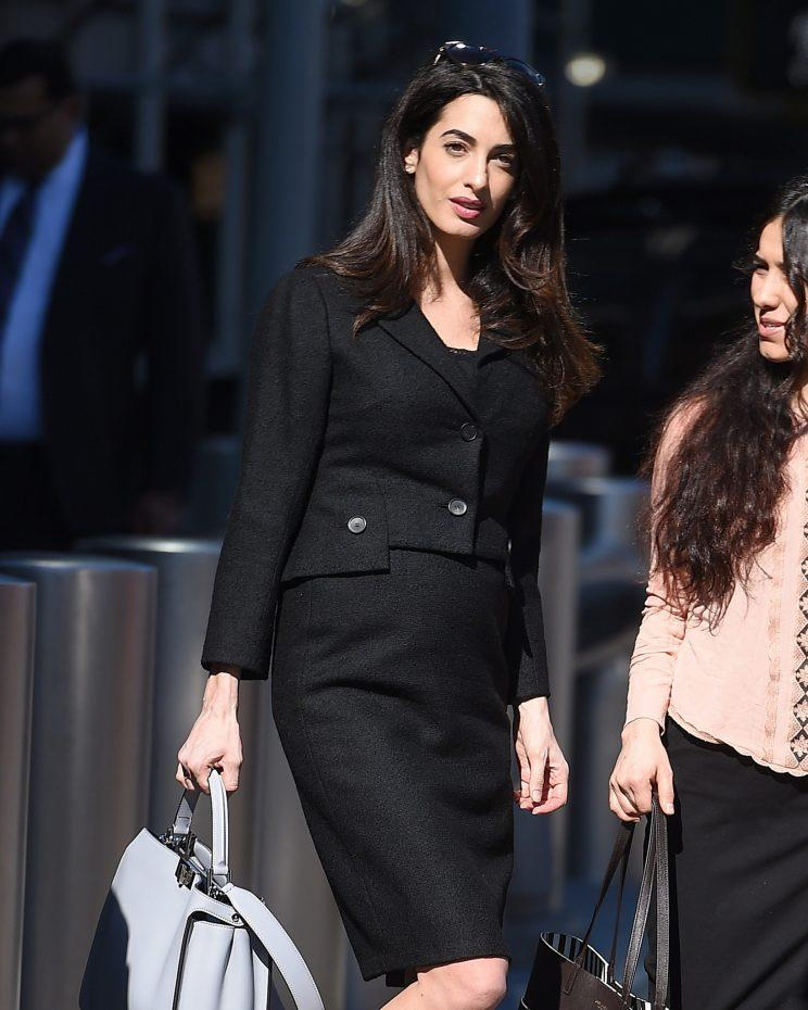 Amal Clooney wearing a skirt suit to the U.N.