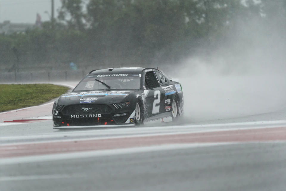 Brad Keselowski (2) drives out of Turn 18 during practice for Sunday's NASCAR Cup Series auto race at the Circuit of the Americas in Austin, Texas, Saturday, May 22, 2021. (AP Photo/Chuck Burton)