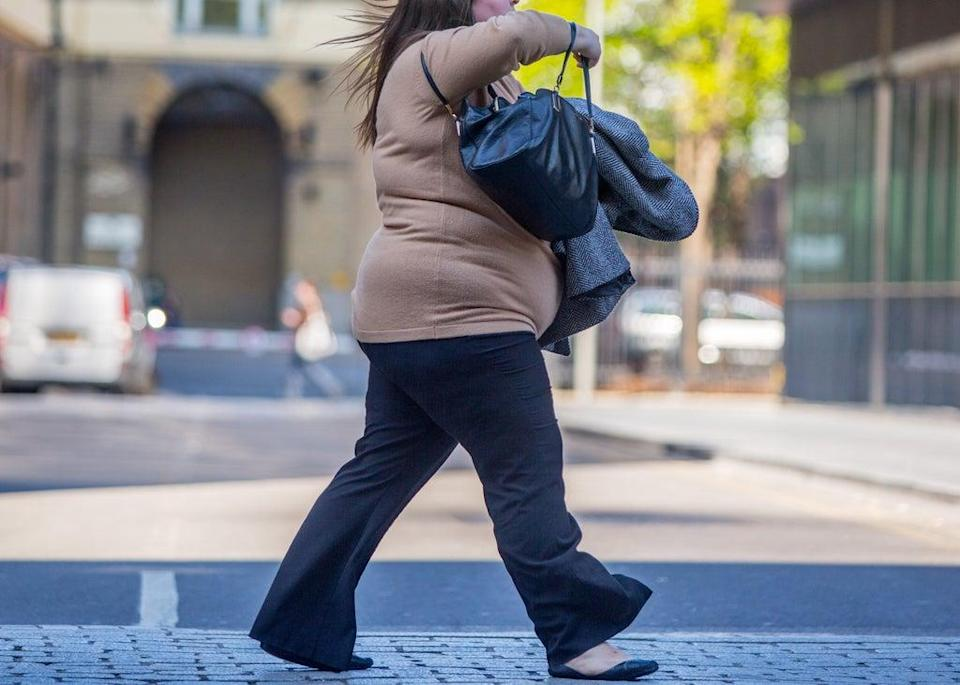 Researchers found weaker brain responses were associated with greater levels of body shame and weight preoccupation (PA) (PA Archive)