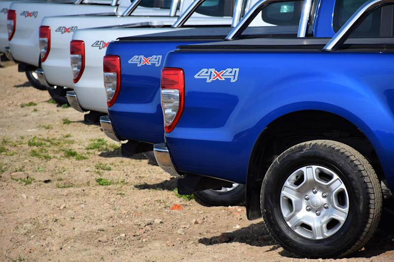 Pultusk, Poland - April, 25th, 2015: Ford Ranger vehicles stopped on the unmade road in a row. The newest generation of Ranger was debut in 2011 on the market. These vehicles are used to get in extremely hard areas and they have payloads from 1 to 1,3 tonnes.