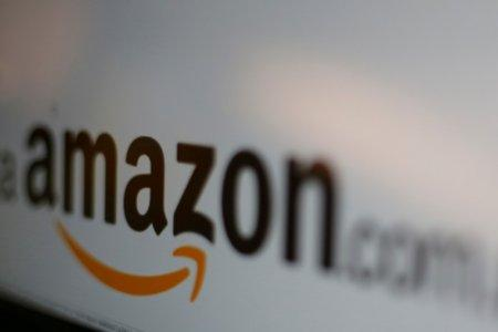 FILE PICTURE - The logo of the web service Amazon is pictured in this June 8, 2017 illustration photo. REUTERS/Carlos Jasso/Illustration