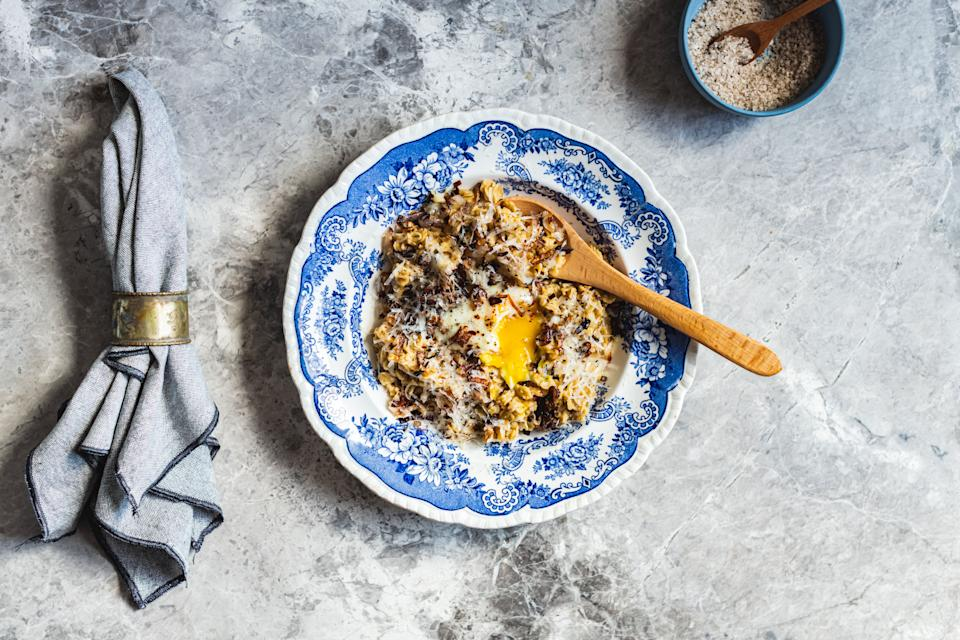 Savory oats, like the ones seen here with eggs, can help prevent sugar crashes later in the day. (Photo: Hein Van Tonder / EyeEm via Getty Images)
