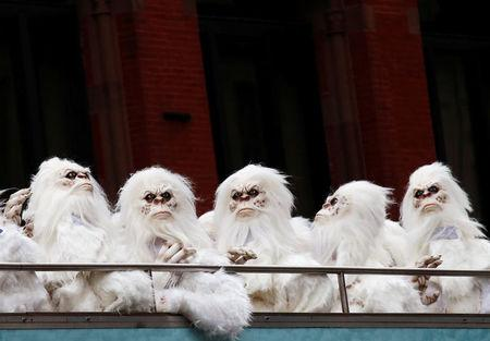 "FILE PHOTO: Actors dressed as a 'Yeti' ride aboard a tour bus during a promotional event for Travel Channel's ""Expedition Unknown: Hunt for the Yeti"" in Manhattan, New York City, U.S. on October 4, 2016.  REUTERS/Brendan McDermid/File Photo"
