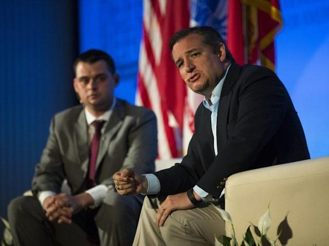 Sen. Ted Cruz, right, with moderator Dan Caldwell, director of Concerned Veterans of America, holds a town hall meeting to address veteran's and health care issues in Austin, Texas. (Photo: Erich Schlegel/Getty Images)