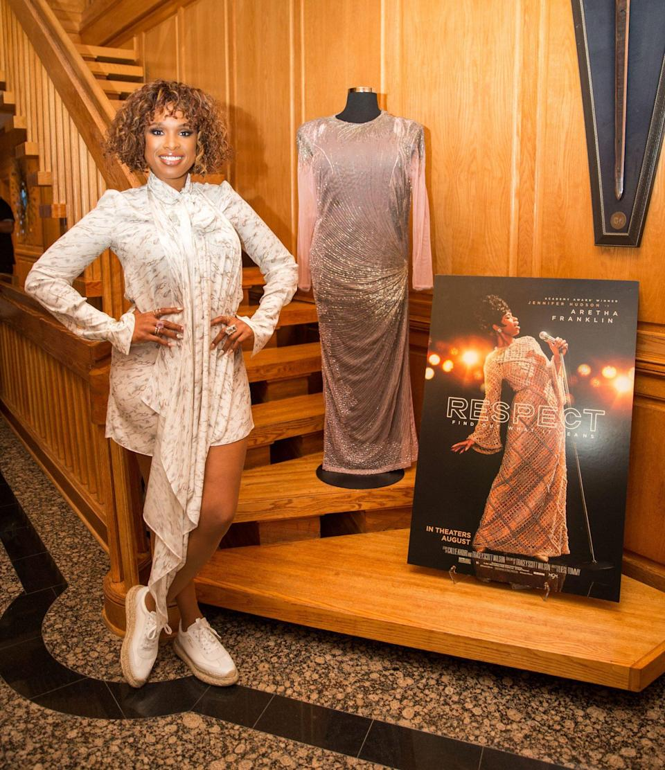 <p>Jennifer Hudson poses with a dress once worn by Aretha Franklin on July 29 while promoting her biopic <em>Respect</em> at the Martha's Vineyard Film Festival in Edgartown, Massachusetts. </p>