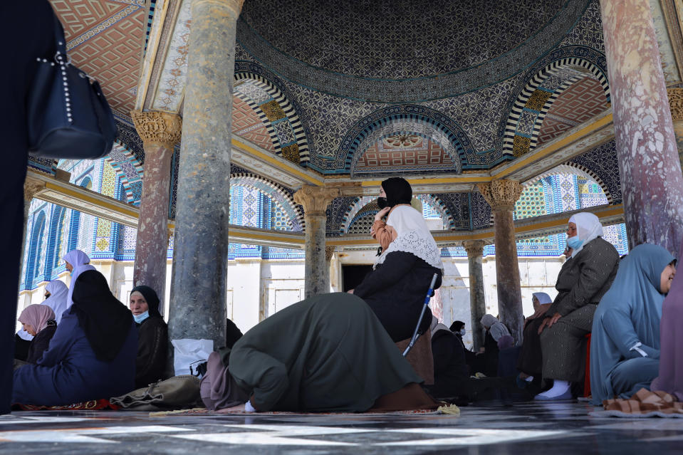 Palestinian women pray during the first Friday of the holy month of Ramadan at the Al Aqsa Mosque compound in Jerusalem's old city, Friday, April. 16, 2021. (AP Photo/Mahmoud Illean)