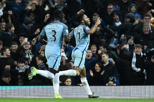 Manchester City's midfielder Raheem Sterling (R) celebrates scoring on December 18, 2016 (AFP Photo/Oli SCARFF )
