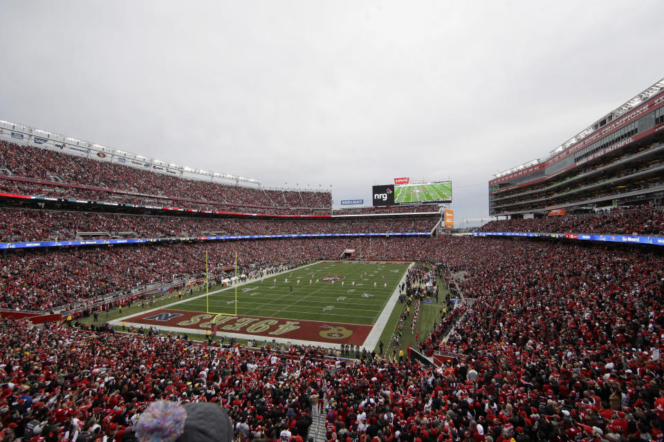 FILE - In this Jan. 19, 2020, file photo, fans at Levi's Stadium watch as the Green Bay Packers kickoff to the San Francisco 49ers during the first half of the NFL NFC Championship football game in Santa Clara, Calif. At a time when America is trying to cope with the financial fallout created by the deadly coronavirus, the renewal of NFL season tickets is not exactly a high priority in the midst of soaring unemployment, business closures and a volatile stock market. Most teams understand this, and have acted accordingly. (AP Photo/Jeff Chiu, File)