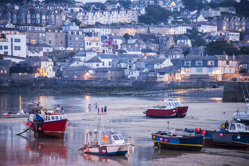 St. Ives, the harbor at low tide, Cornwall, England. St Ives is a town of 11,165 inhabitants on the north coast of Cornwall, England, overlooking the bay of the same name, off the coast of which is the island of Godrevy Island. the economy of the city is given by fishing and tourism