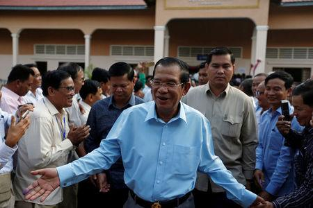 Cambodia's Prime Minister and President of the Cambodian People's Party (CPP), Hun Sen is surrounded by his commune counselors during a senate election in Takhmao, Kandal province, Cambodia February 25, 2018. REUTERS/Samrang Pring