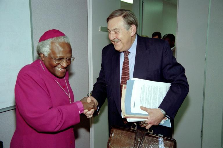 October 14, 1997: South Africa's then foreign minister, Pik Botha, shakes hands with Tutu as he arrives at the Truth and Reconciliation Commision (AFP/Odd ANDERSEN)