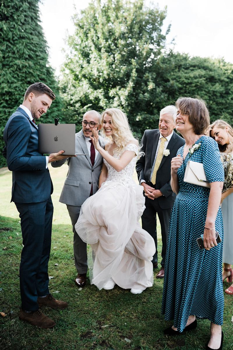 Matheus Matioli, 29, and Naomi Richardson, 29, London, Zooming loved ones during wedding (Photo: Katie Rogers (@katierogersphotography))
