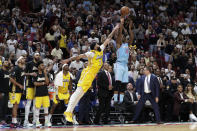Miami Heat forward Jimmy Butler (22) attempts a three-point basket at the buzzer as Los Angeles Lakers forward Anthony Davis (3) defends during the second half of an NBA basketball game, Friday, Dec. 13, 2019, in Miami. (AP Photo/Lynne Sladky)