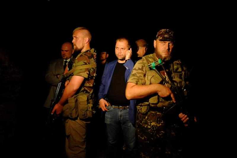 "Self-proclaimed Prime Minister of the pro-Russian separatist ""Donetsk People's Republic"" Alexander Borodai (C) stands as he arrives on the site of the crash of a malaysian airliner carrying 298, in rebel-held east Ukraine, on July 17, 2014"