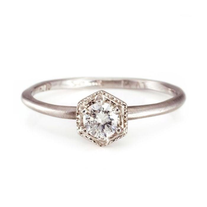 """<p>Simple and sweet, the <a href=""""https://www.popsugar.com/buy/Platinum-White-Diamond-Hexagon-Ring-531793?p_name=Platinum%20White%20Diamond%20Hexagon%20Ring&retailer=catbirdnyc.com&pid=531793&price=1%2C200&evar1=fab%3Aus&evar9=47015200&evar98=https%3A%2F%2Fwww.popsugar.com%2Ffashion%2Fphoto-gallery%2F47015200%2Fimage%2F47015999%2FHexagons-Platinum-White-Diamond-Hexagon-Ring&list1=shopping%2Cjewelry%2Crings%2Cengagement%20rings&prop13=mobile&pdata=1"""" rel=""""nofollow noopener"""" class=""""link rapid-noclick-resp"""" target=""""_blank"""" data-ylk=""""slk:Platinum White Diamond Hexagon Ring"""">Platinum White Diamond Hexagon Ring</a> ($1,200) can be stacked with other rings.</p>"""