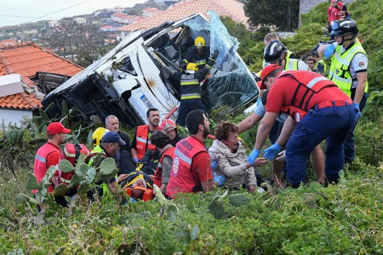 Rescue workers helped survivors at the crash site