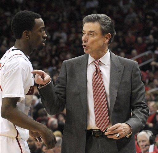 Louisville coach Rick Pitino, right, talks to Russ Smith during the second half of their NCAA college basketball game against DePaul Saturday, Jan. 14, 2012 in Louisville, Ky. Louisville defeated DePaul 76-59. (AP Photo/Timothy D. Easley)
