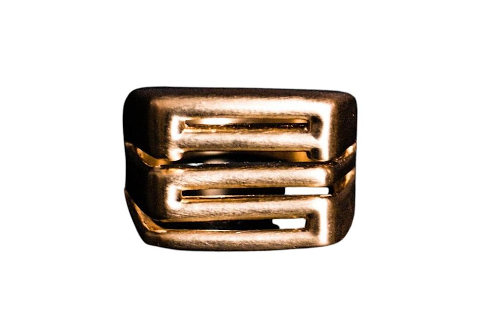 """$450, A. Sauvage. <a href=""""https://shop.asauvage.com/products/as-adinkra-ring?_pos=1&_sid=6e9a2a399&_ss=r"""" rel=""""nofollow noopener"""" target=""""_blank"""" data-ylk=""""slk:Get it now!"""" class=""""link rapid-noclick-resp"""">Get it now!</a>"""