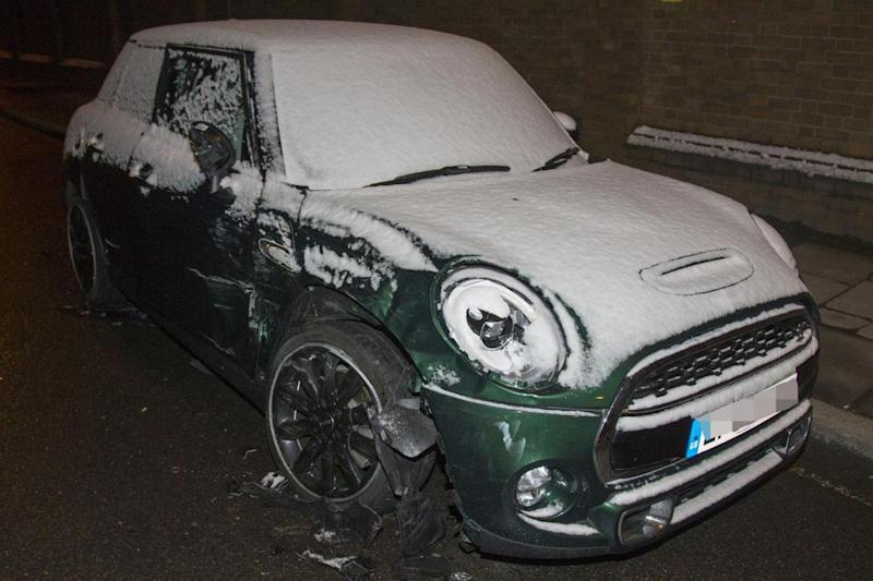 A green Mini which was involved in the crash (Splash News)