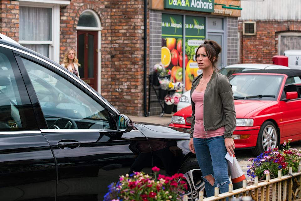 FROM ITV  STRICT EMBARGO - No Use Before Tuesday 27th July 2021  Coronation Street - 10396  Friday 6th August 2021 - 1st Ep  Fed up with the parking chaos on the street, Shona Platt [JULIA GOULDING] produces some homemade parking tickets. When Todd Grimshaw [GARETH PIERCE] dumps the hearse outside No.8, Shona slaps one on the windscreen.  Picture contact David.crook@itv.com  Photographer - Danielle Baguley  This photograph is (C) ITV Plc and can only be reproduced for editorial purposes directly in connection with the programme or event mentioned above, or ITV plc. Once made available by ITV plc Picture Desk, this photograph can be reproduced once only up until the transmission [TX] date and no reproduction fee will be charged. Any subsequent usage may incur a fee. This photograph must not be manipulated [excluding basic cropping] in a manner which alters the visual appearance of the person photographed deemed detrimental or inappropriate by ITV plc Picture Desk. This photograph must not be syndicated to any other company, publication or website, or permanently archived, without the express written permission of ITV Picture Desk. Full Terms and conditions are available on  www.itv.com/presscentre/itvpictures/terms